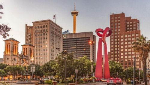 Beautiful capture of downtown at sunset featuring local landmarks like the torch of friendship, san Fernando cathedral, and Tower of the Americas.